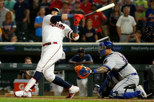 Minnesota Twins designated hitter Nelson Cruz fouls out with the bases loaded and a full count during the ninth inning of the team's baseball game against the New York Mets on Tuesday, July 16, 2019, in Minneapolis. The Mets won, 3-2.