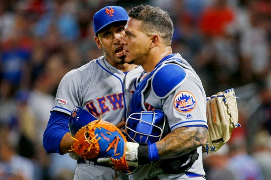 New York Mets relief pitcher Edwin Diaz and catcher Wilson Ramos celebrate the team's 3-2 win over the Minnesota Twins in a baseball game Tuesday, July 16, 2019, in Minneapolis.