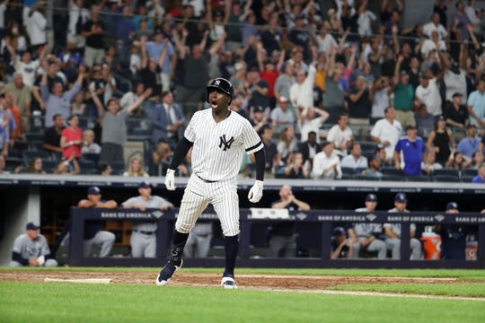 Didi Gregorius #18 of the New York Yankees reacts after hitting a grand slam in the eighth inning against the Tampa Bay Rays during their at Yankee Stadium on July 16, 2019 in New York.