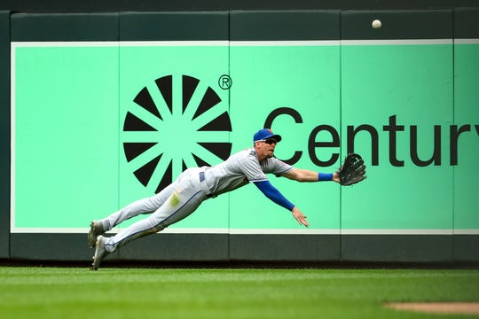 New York Mets right fielder Jeff McNeil (6) dives for a fly ball against the Minnesota Twins in the second inning at Target Field.