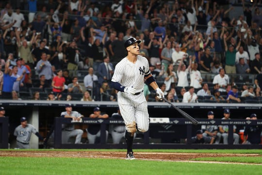 Aaron Judge #99 of the New York Yankees hits the go ahead two run home run in the eighth inning against the Tampa Bay Rays during their at Yankee Stadium on July 16, 2019 in New York.