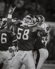 In this 1991 photo, the Giants' Carl Banks celebrates after tackle.
