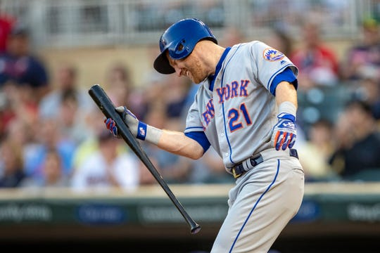 Jul 16, 2019; Minneapolis, MN, USA; New York Mets third baseman Todd Frazier (21) reacts after striking out in the fourth inning against the Minnesota Twins at Target Field.