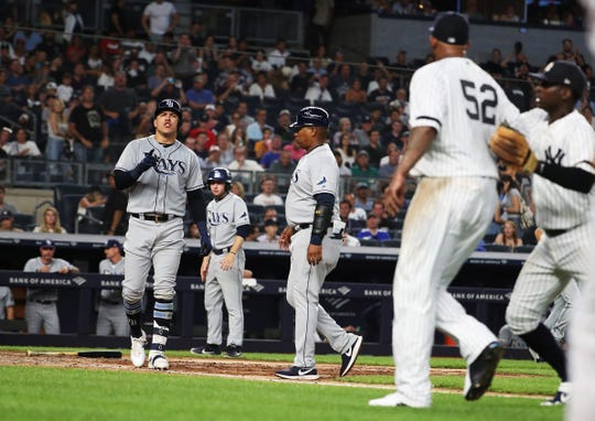 Avisail Garcia, left, of the Tampa Bay Rays has words with CC Sabathia #52 of the New York Yankees after an at bat in the sixth inning during their at Yankee Stadium on July 16, 2019 in New York.