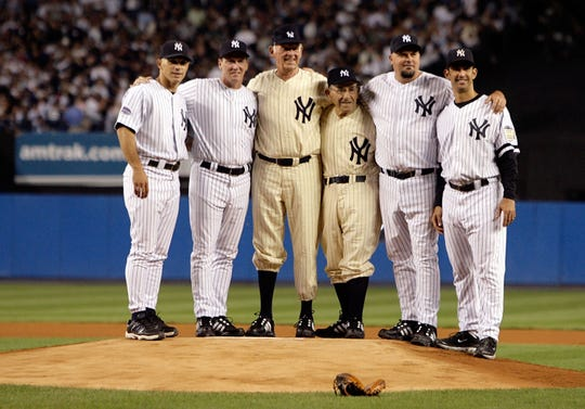 The Yankees pitchers who threw perfect games and the catchers they threw to stand on the mound prior to the start of the last regular season game at Yankee Stadium in New York on Sept. 21, 2008, as the Yankees hosted the Baltimore Orioles. From left to right: Joe Girardi, David Cone, Don Larsen, Yogi Berra, David Wells and Jorge Posada. The Yankees were playing their final season in the 85-year-old ball park before moving into the new Yankee Stadium across the street to start the 2009 season.