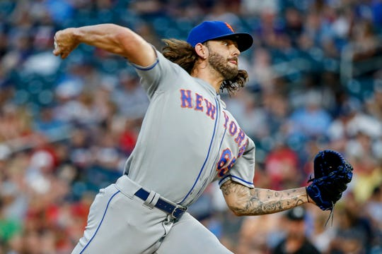 New York Mets relief pitcher Robert Gsellman throws to a Minnesota Twins batter during the fifth inning of a baseball game Tuesday, July 16, 2019, in Minneapolis.