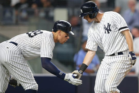 Jul 16, 2019; Bronx, NY, USA; New York Yankees third baseman DJ LeMahieu (26) celebrates his solo home run against the Tampa Bay Rays with New York Yankees right fielder Aaron Judge (99) during the sixth inning at Yankee Stadium. Mandatory Credit: Brad Penner-USA TODAY Sports