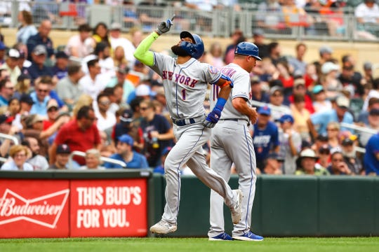 New York Mets shortstop Amed Rosario (1) celebrates after hitting a solo home run against the Minnesota Twins in the third inning at Target Field.