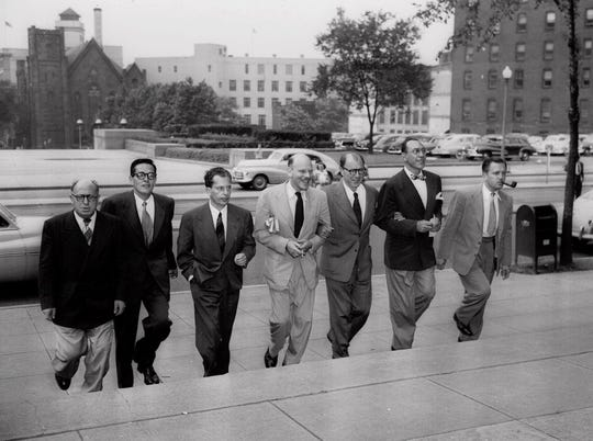 Seven Hollywood figures arrive at U.S. Federal Court in Washington June 22, 1950, to face charges of contempt for defiance of the House Committee on Un-American Activities. From left to right, Samuel Ornitz, Ring Lardner Jr., Albert Maltz, Alvah Bessie, Lester Cole, Herbert Biberman, and Edward Dmytryk. Dmytryk, a member of the Hollywood Ten who served prison time during the Red Scare-era witch hunts of the 1940s and was blacklisted until he named names of his communist comrades.
