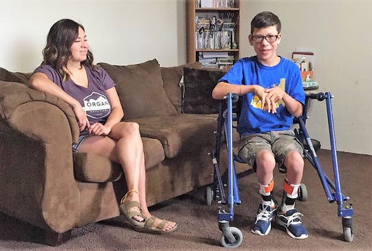 Jacob Avalos, 13, right, and his mom Claudia Avalos talk at their home in Mesilla Park on Tuesday, Jan. 16, 2019, two days before scheduled surgery to loosen Jacob's leg muscles, allowing him to have more mobility.