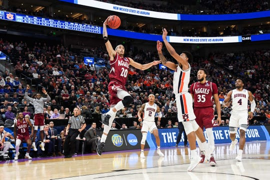 Mar 21, 2019; Salt Lake City, UT, USA; New Mexico State Aggies guard Trevelin Queen (20) goes up for a shot during the second half in the first round of the 2019 NCAA Tournament against the Auburn Tigers at Vivint Smart Home Arena. Mandatory Credit: Kirby Lee-USA TODAY Sports