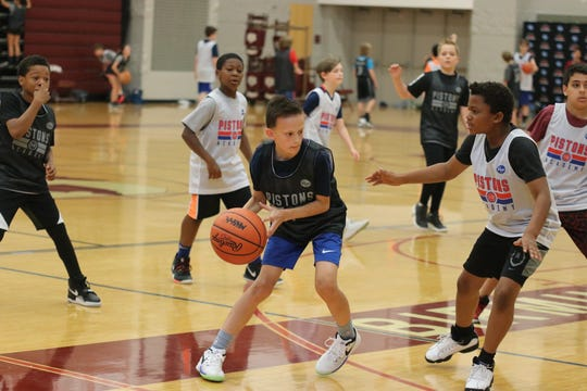 Campers scrimmage during a Pistons summer camp earlier this summer in Birmingham.