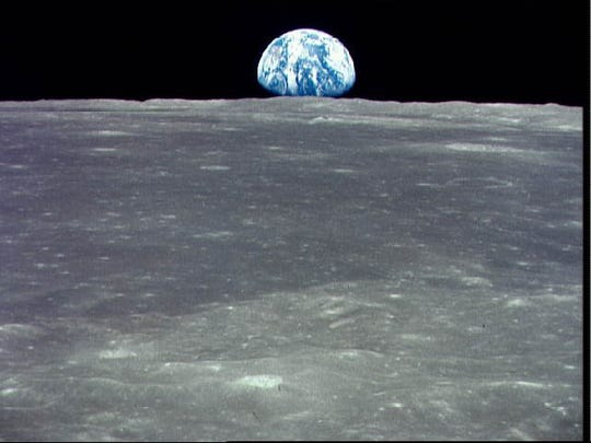This view of the Earth rising over the Moon's horizon was taken from the Apollo 11 spacecraft in 1969.