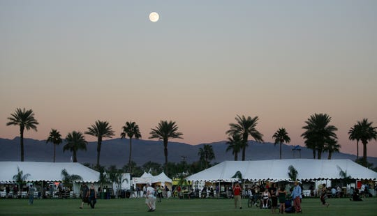 The moon shines over the tents during Phish Festival 8 at the Empire Polo Fields on Sunday, Nov. 1, 2009, in Indio.
