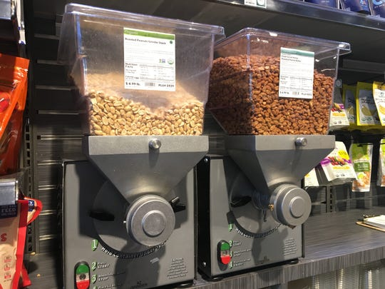 Whole Foods nut grinders dispense nut butter fresh for customers. A suspect used one to distract a woman and steal her wallet last year, authorities say.