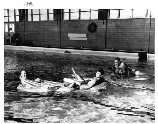 From left, astronauts Pete Conrad, John Young and James McDivitt are pictured in a training pool at Naval Air Station Pensacola in the early 1960s.
