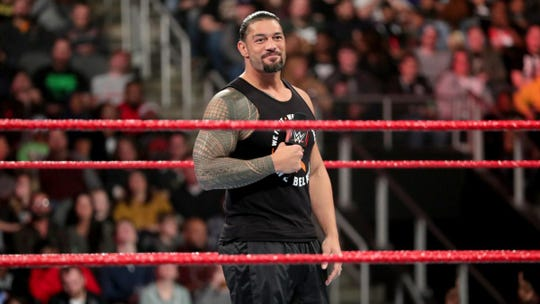 Pensacola native Roman Reigns smiles as he announces his remission from leukemia on the Feb. 25 edition of Monday Night Raw.