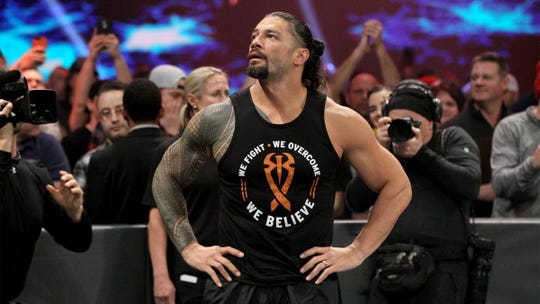 Pensacola native Roman Reigns looks out into the crowd before announcing his remission from leukemia on the Feb. 25 edition of Monday Night Raw.