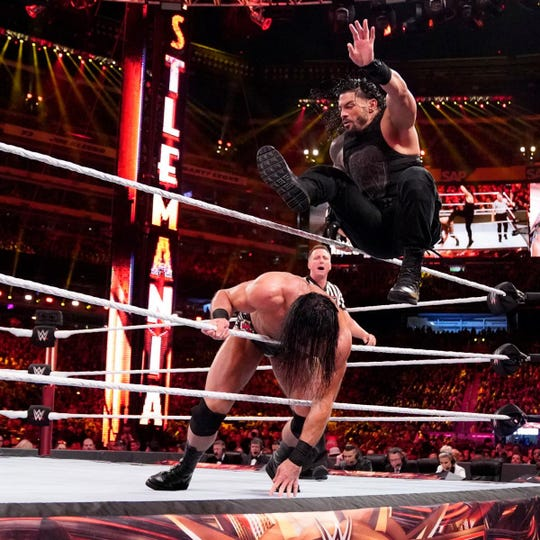 Pensacola's Roman Reigns squares off against Drew McIntyre at WWE WrestleMania in April in New York City.