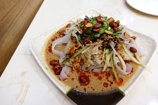 Signature liang pi with bean sprouts, cucumber, scallions, cilantro, peanuts, gluten and sesame paste at Happy Bao's in Mesa.