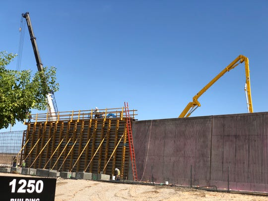 Crews work on a new bridge that will connect Interstate 10 to Fairway Drive in Avondale.