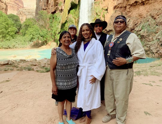 The Havasupai Tribal Council poses with Beyoncé at Havasu Falls. From left to right, Chairwoman Muriel Uqualla,  Councilman Richard Watahomigie, Beyoncé, Councilman Claudius Putesoy and Vice Chairman Matthew Putesoy.