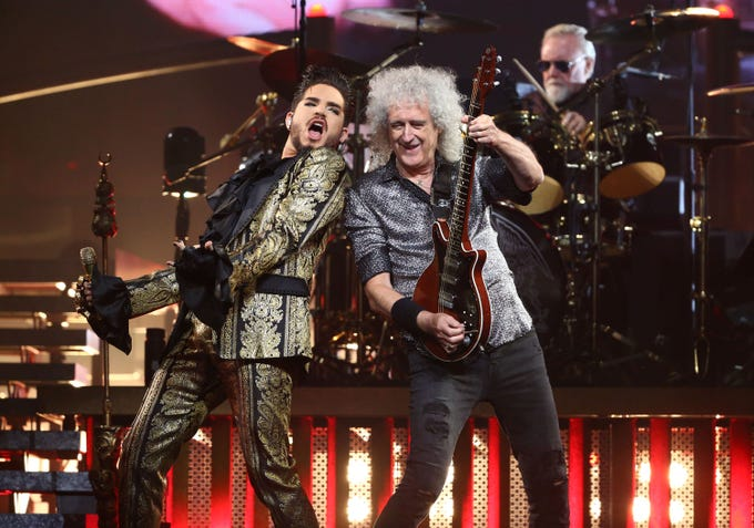 Adam Lambert, Brian May and Roger Taylor of Queen + Adam Lambert perform during their Rhapsody Tour at Talking Stick Resort Arena on July 16, 2019 in Phoenix, Ariz.