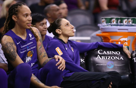 Phoenix Mercury guard Diana Taurasi watches the action from the bench with a back injury against the Dallas Wings in the first half at Talking Stick Resort Arena on July 17, 2019 in Phoenix, Ariz.