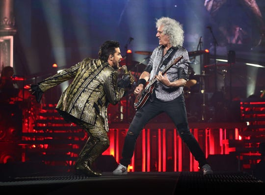 Adam Lambert and Brian May of Queen + Adam Lambert perform during their Rhapsody Tour at Talking Stick Resort Arena on July 16, 2019 in Phoenix, Ariz.