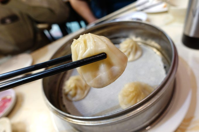 Seafood xiao long bao with pork, shrimp, crab roe and scallions at Happy Bao's in Mesa.