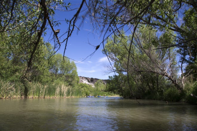 Kayakers paddle, May 11, 2016, down the Verde River near Camp Verde, Arizona.