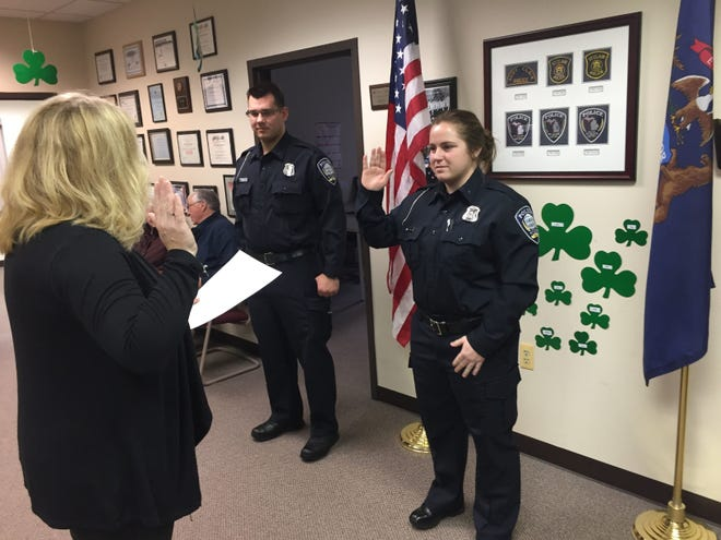 St. Clair City Clerk Annette Sturdy, left, swears in new police officers during a ceremony Wednesday, Feb. 28, 2018, at St. Clair City Hall. She was appointed interim city superintendent in July 2019.
