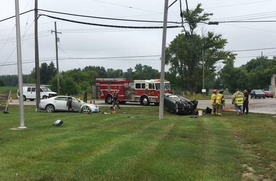 Rescue crews respond to a rollover crash Wednesday afternoon at Lapeer and Range roads in Kimball Township.