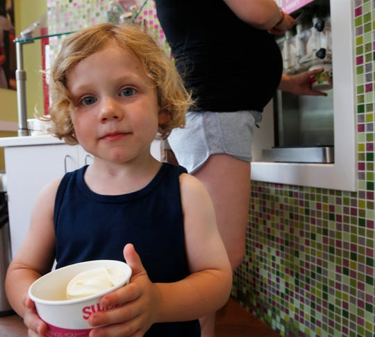Grayson Drumm of Carmel with a cup of frozen yogurt at Sweet Frog Frozen Yogurt in the Town of Poughkeepsie on July 17, 2019.