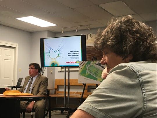 Woodstock 50 organizer Michael Lang, right, listens during the Vernon Planning Board meeting of July 16, 2019.