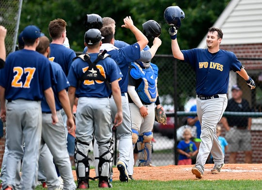 Steve Pokopec is greeted by the Mount Wolf team after connecting with a solo home run against Stoverstown, Tuesday, July 16, 2019.  John A. Pavoncello photo