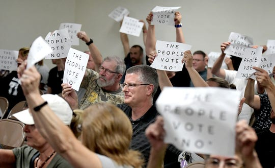 "Residents make their feelings known during the North Codorus Township supervisor's vote on police services during a meeting Tuesday, July 16, 2019. The supervisors unanimously voted ""yes"" to employ the services Northern York County Regional Police in the township. Bill Kalina photo"