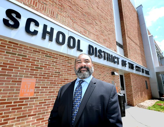 Outgoing York City School District Superintendent Eric Holmes poses outside the district administration building Wednesday, July 17, 2019. His 32-year career with the district began as a high school social studies teacher. He has been superintendent since 2013. Bill Kalina photo