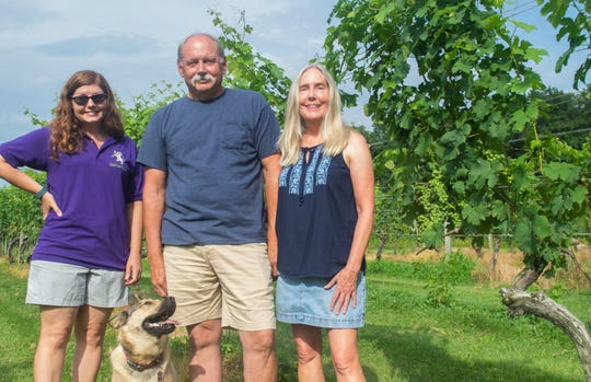 Left to right: Rachel Ewing-Webb, 46, David Ewing, 65, and Sue Ewing, 63, and their dog Reisling, of Balla Cloiche Vineyards in Stewartstown.