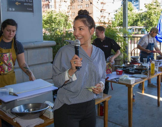 Britton Griffith of Reno Engineering emcees the Chefs Al Fresco event at Campo Reno Monday, July 15, 2019.