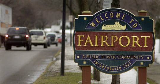 A welcome sign in the Village of Fairport along West Church Street.