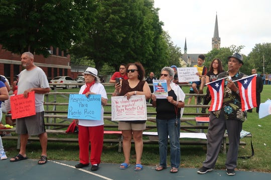Protesters gather Wednesday in Don Samuel Torres Park in Rochester to call for the resignation of Puerto Rico Gov. Ricardo Rossello.