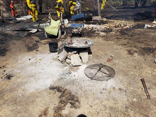 A 2.5-acre fire broke out near Lorina Drive in Happy Valley on Tuesday after people using this fire pit to cook lost control of the fire.