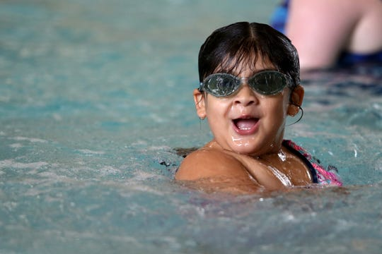 Alyssa Barajas, 4, of Salem, swims at the Kroc Center in Keizer on July 17, 2019.