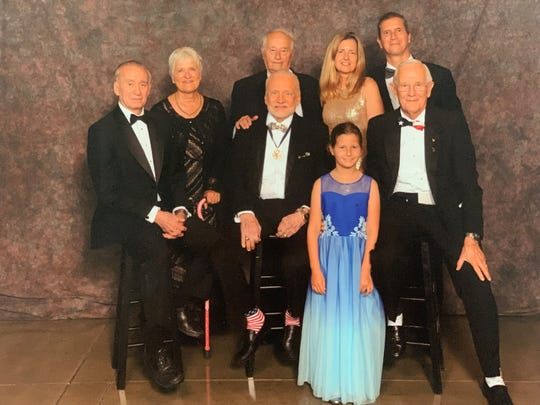 At the Apollo 11's 50th anniversary gala at the Ronald Reagan Presidential Library in Simi Valley, California on July 13, 2019, pictured clockwise from left: astronaut Walt Cunningham, Mary Jane Vonnegut, Martin Vonnegut, Kimberly Kotnik, Andrew Vonnegut, astronaut Charlie Duke, Katie Vonnegut and astronaut Buzz Aldrin