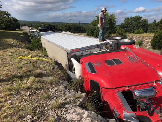 A truck and trailer flipped on U.S. Highway 83, 10 miles north of Junction, after a driver swerved to miss a deer Wednesday, July 17, 2019.