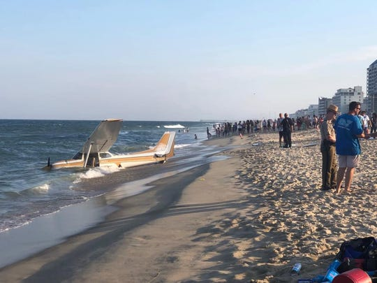 The small plane that crashed just off the beach in Ocean City is shown is this image. The pilot was able to walk away from the crash. The tail number in this image was removed by the town.