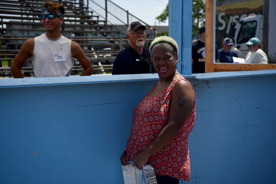 Romaine Henderson, a Crisfield resident, waits eagerly at the top of the line at the 43rd Annual Tawes Crab and Clam Bake in Crisfield, Maryland, on July 17, 2019, excited for the stand to begin giving out crabs.