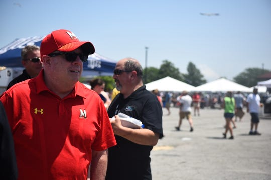 Maryland Gov. Larry Hogan braves the baking pavement at the 43rd Annual Tawes Crab and Clam Bake in Crisfield on July 17, 2019, speaking to constituents and scooping out the eats.