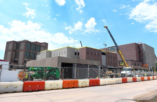 Construction on a new wing of the Minnehaha County Jail continues Wednesday, July 17, in Sioux Falls. The addition will include a new intake facility, as the current system is not meant to process the large number of inmates the jail sees each year.